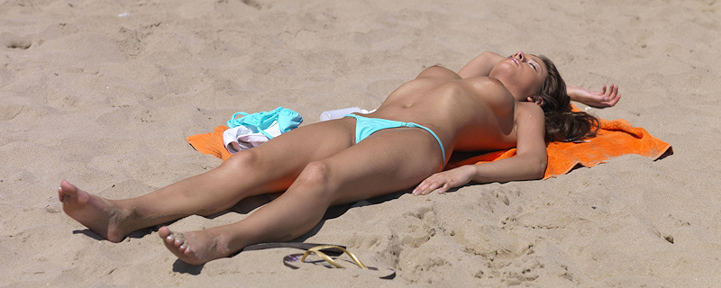 Anastasia sunbathing on the beach