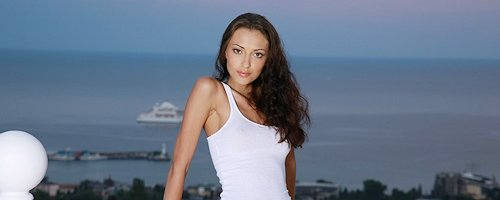 Anna Sbitnaya in white tank top