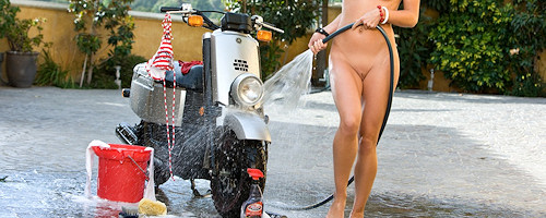 Ariel Nichole washes her scooter