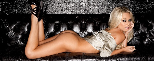 Brittany Barbour on black leather couch