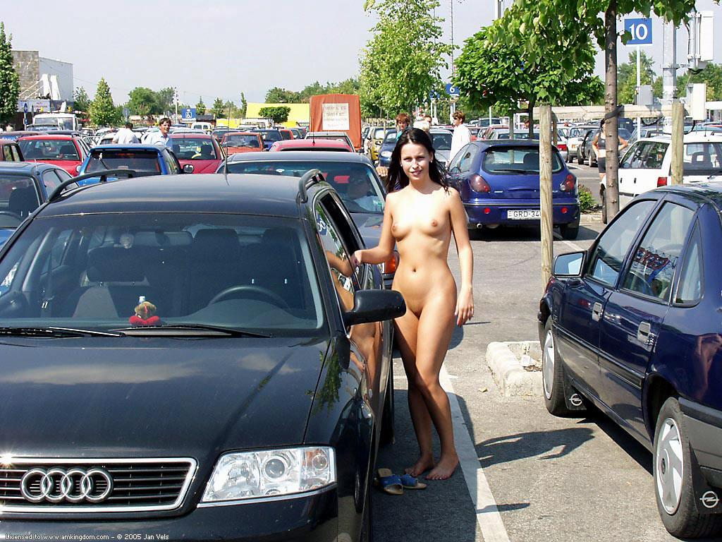 Brunette naked in public
