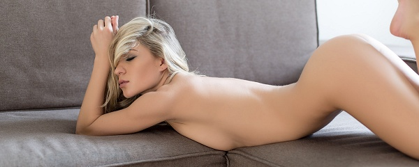 Candice naked on the sofa