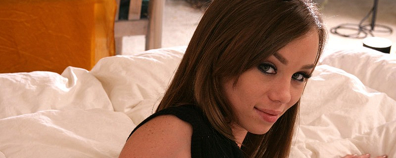 Capri Anderson lying on bed