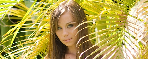 Capri Anderson under the palm trees