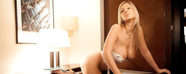 Carol Goldnerova on leather armchair