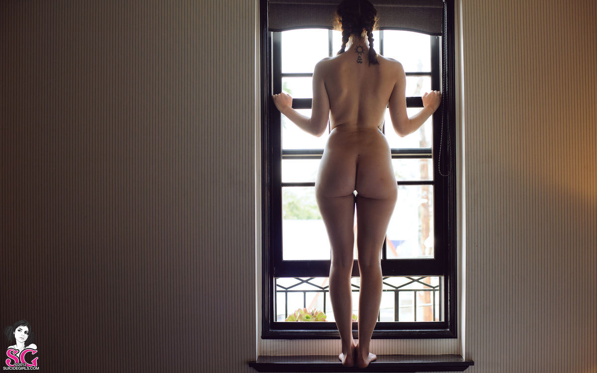 Girl in window nude