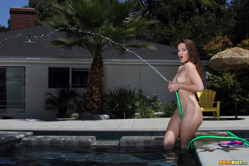 dani-daniels-pool-garden-hose-bikini-riot-15
