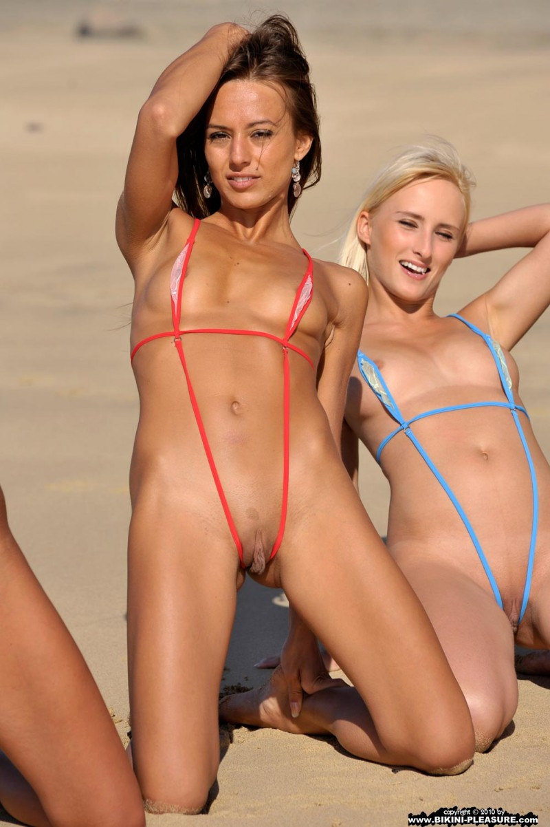 Girls wearing micro thong bikini something is