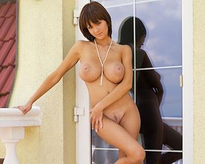 gabrielle-big-tits-balcony-mcnudes