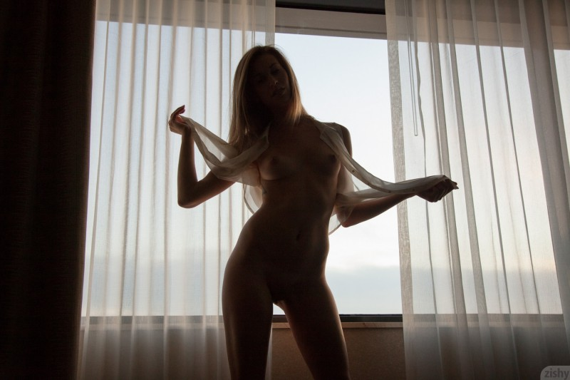 geri-burgess-window-naked-zishy-21