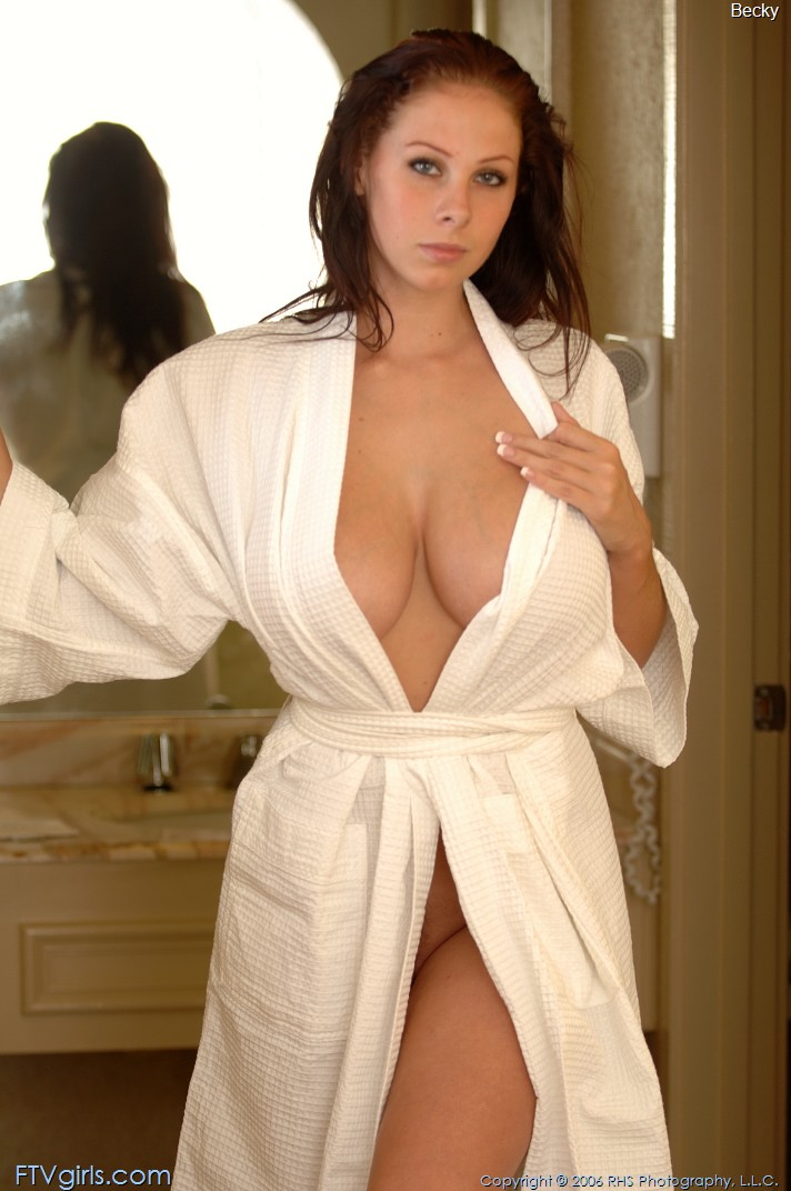 Three nude girls in bath robes