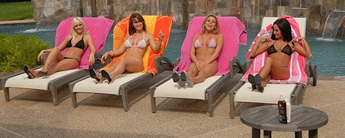 Girls sunbathing by the pool