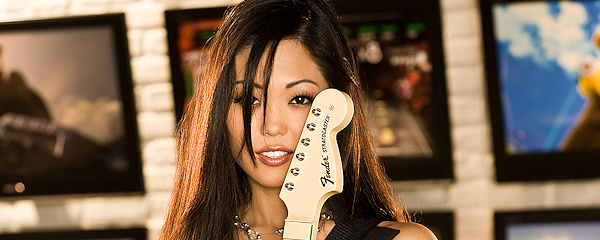 Grace Kim playing the guitar