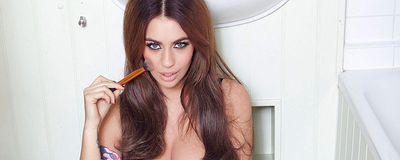 Holly Peers doing makeup in bathroom