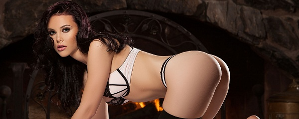 Iana Little by the fireplace