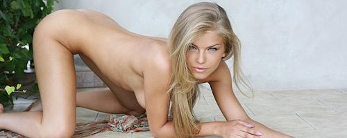 Inga naked on the balcony