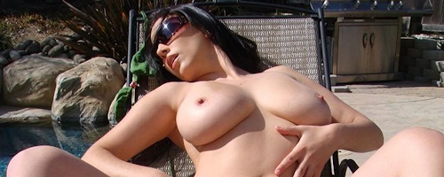 Jelena Jensen sunbathing by the pool