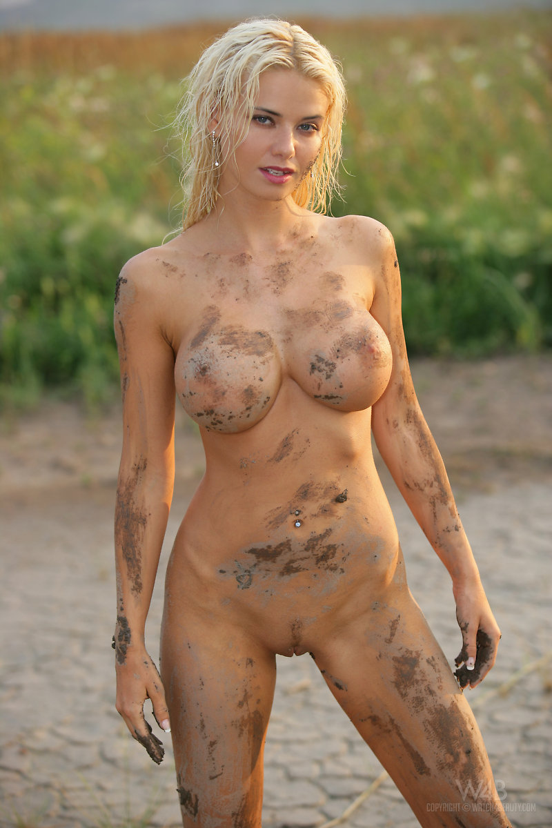 Nude women in mud has