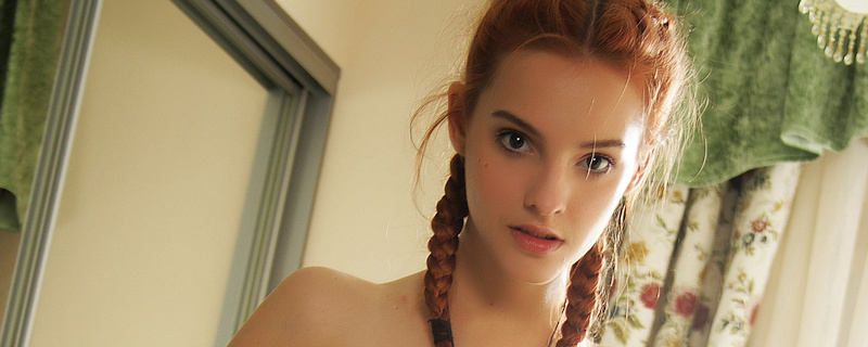 Kira W – Redhead with pigtails