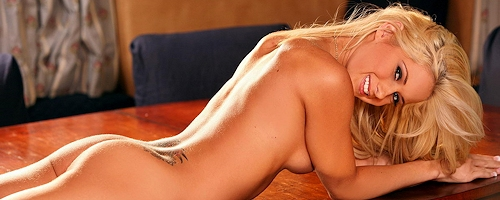 Kori Koether strips on the table