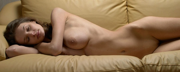 Kristina naked on sofa