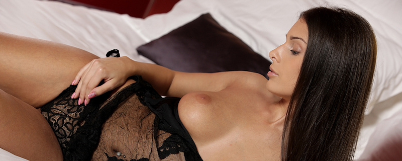 Lia Taylor lying on the bed
