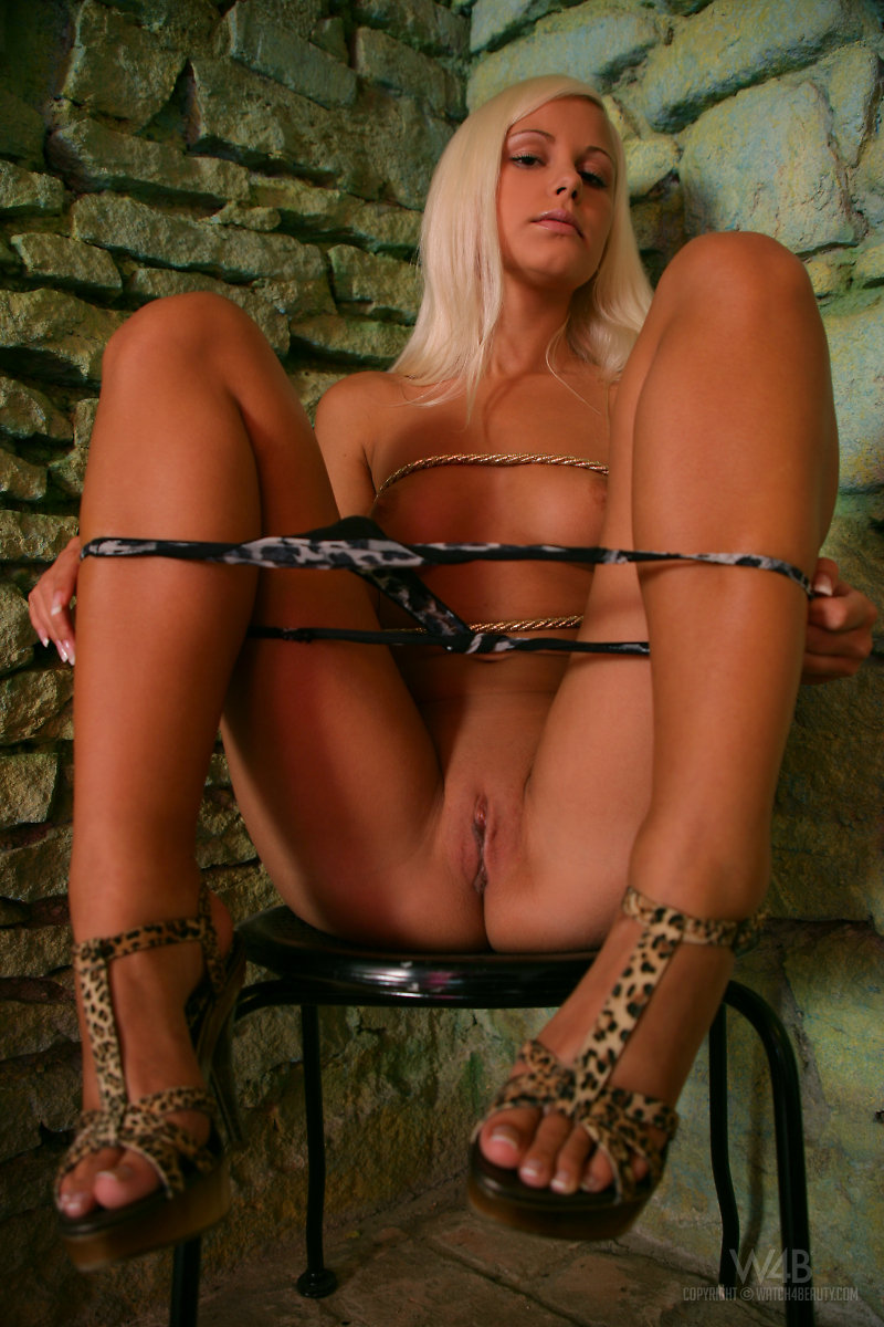 topless girl tied to chair