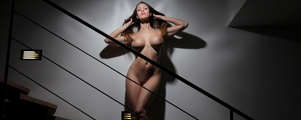 Luciana naked on staircase