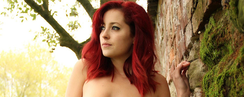 Lucy Collett naked against the wall