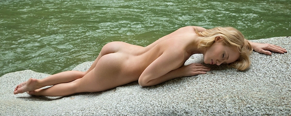 Mia naked by the river