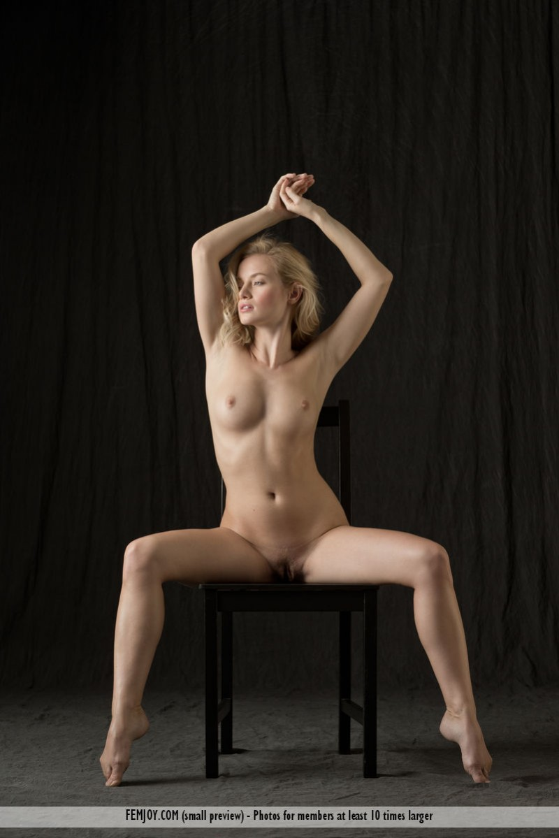 Hairy nude girl sitting in chair