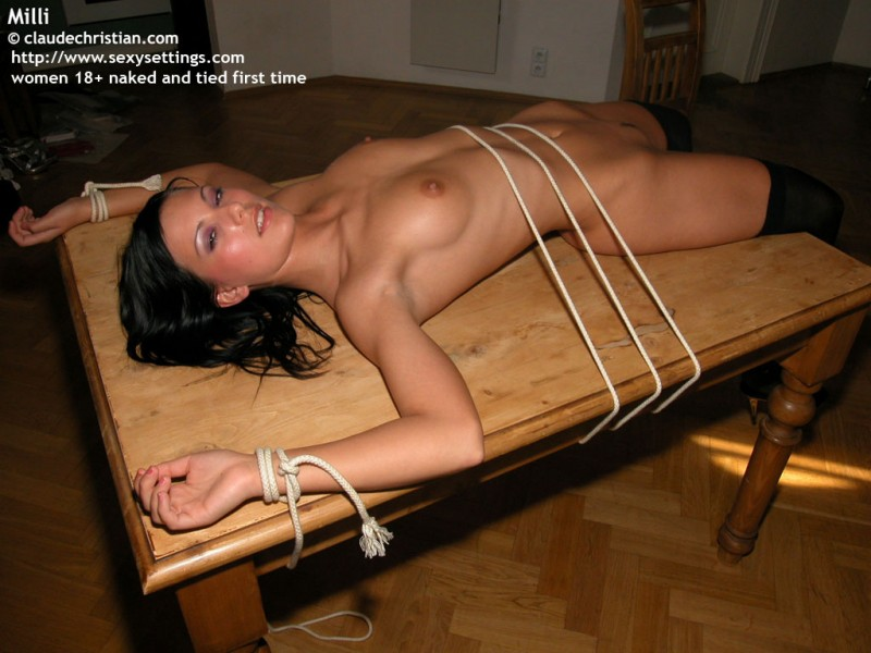Bound naked on table thought