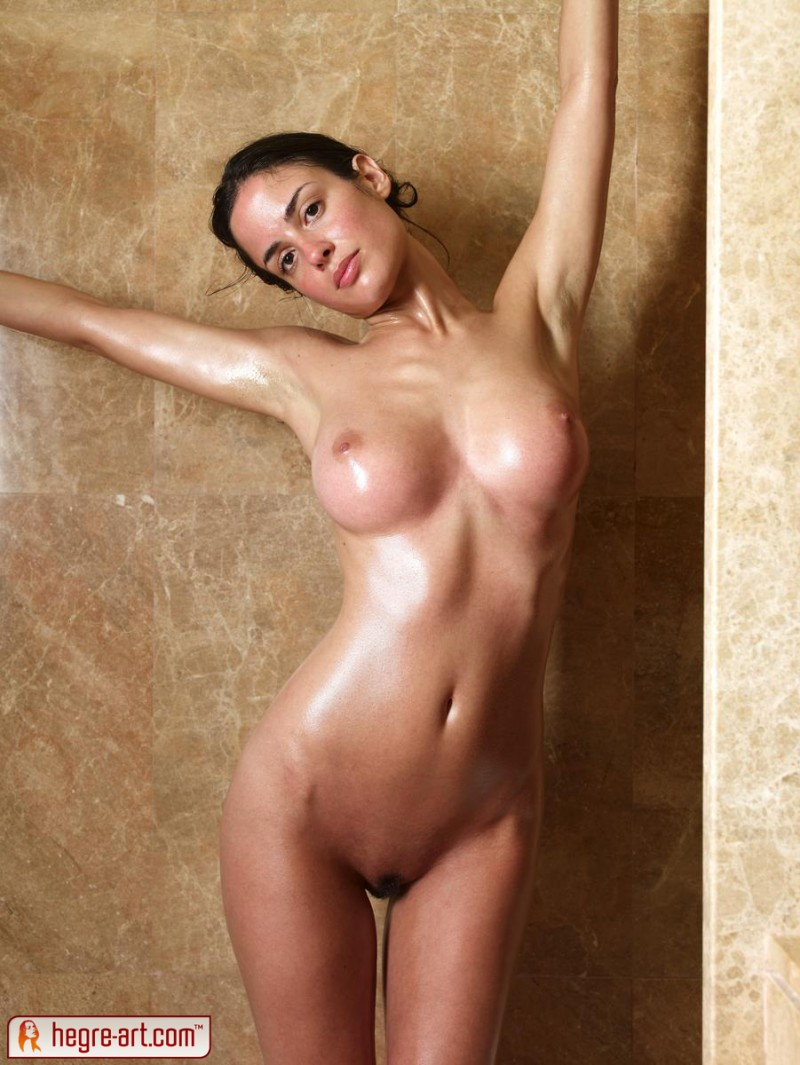 Two girls nude in a shower