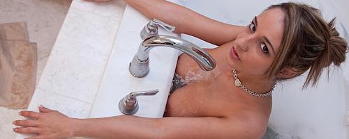 Nikki Sims takes a bath