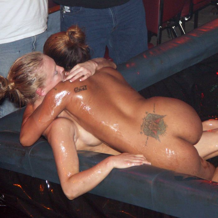 Girls naked oil wrestling