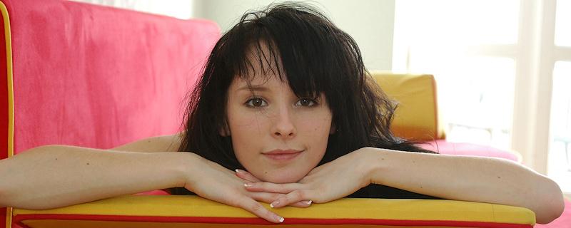 Olga naked on sofa