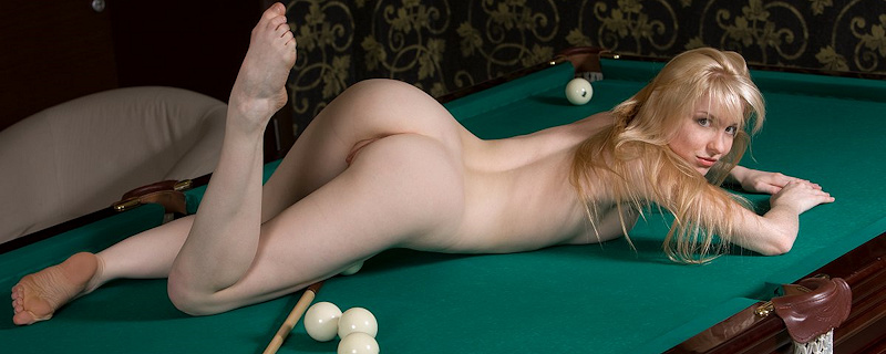 Polly naked on pool table