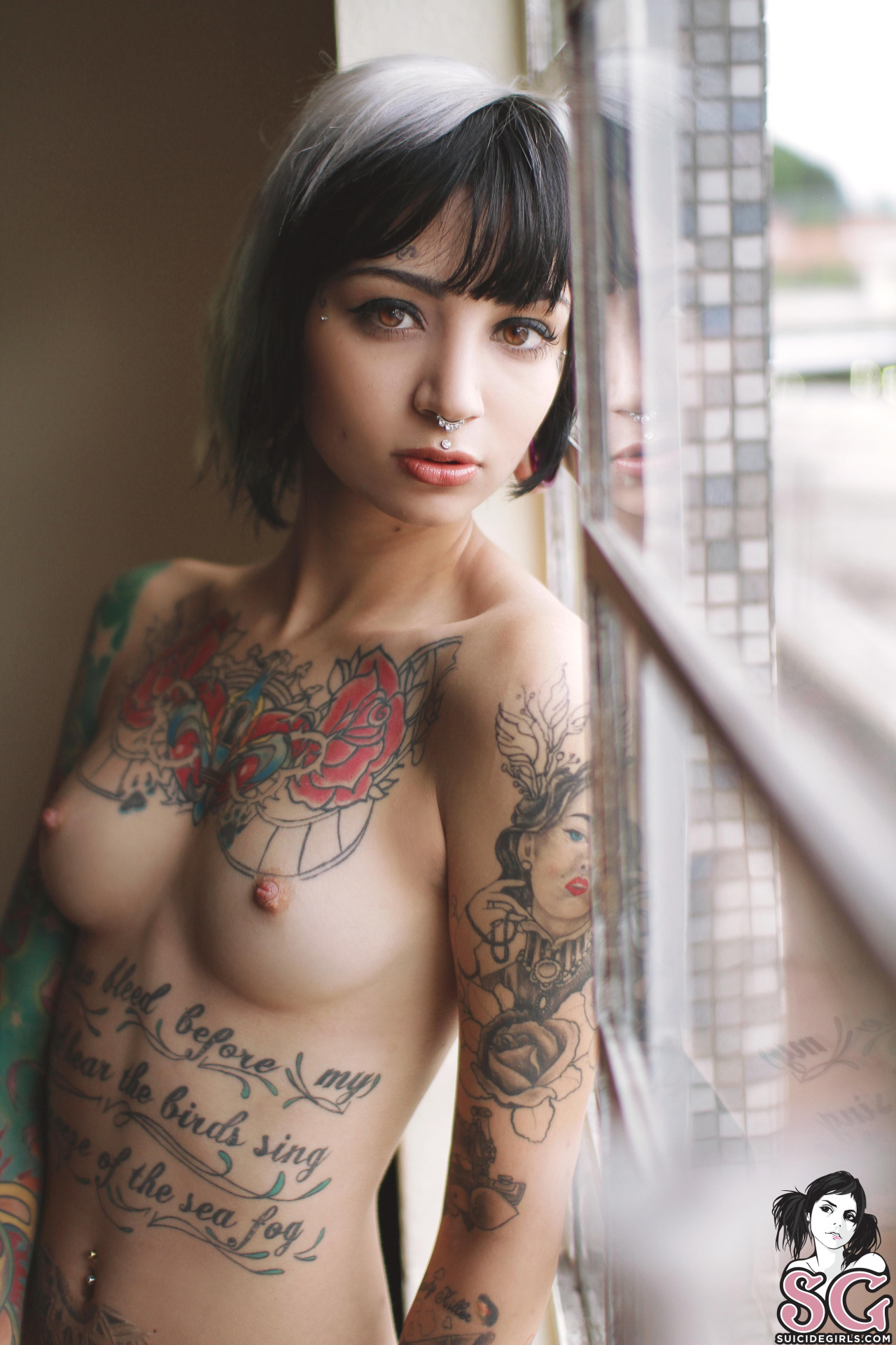 Nude girls with tattoos are not