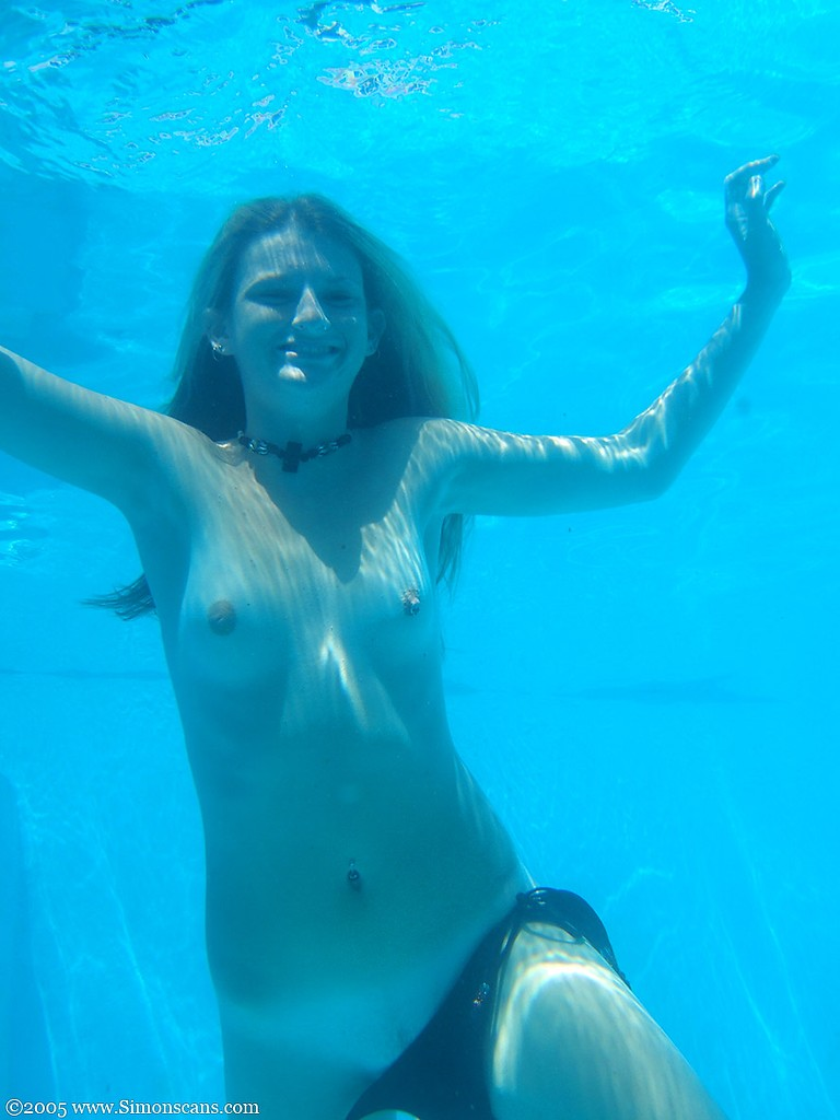 Young naked girls swimming