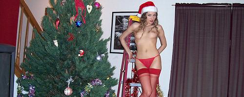 Thea decorates the Christmas tree