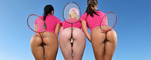 Threesome playing badminton