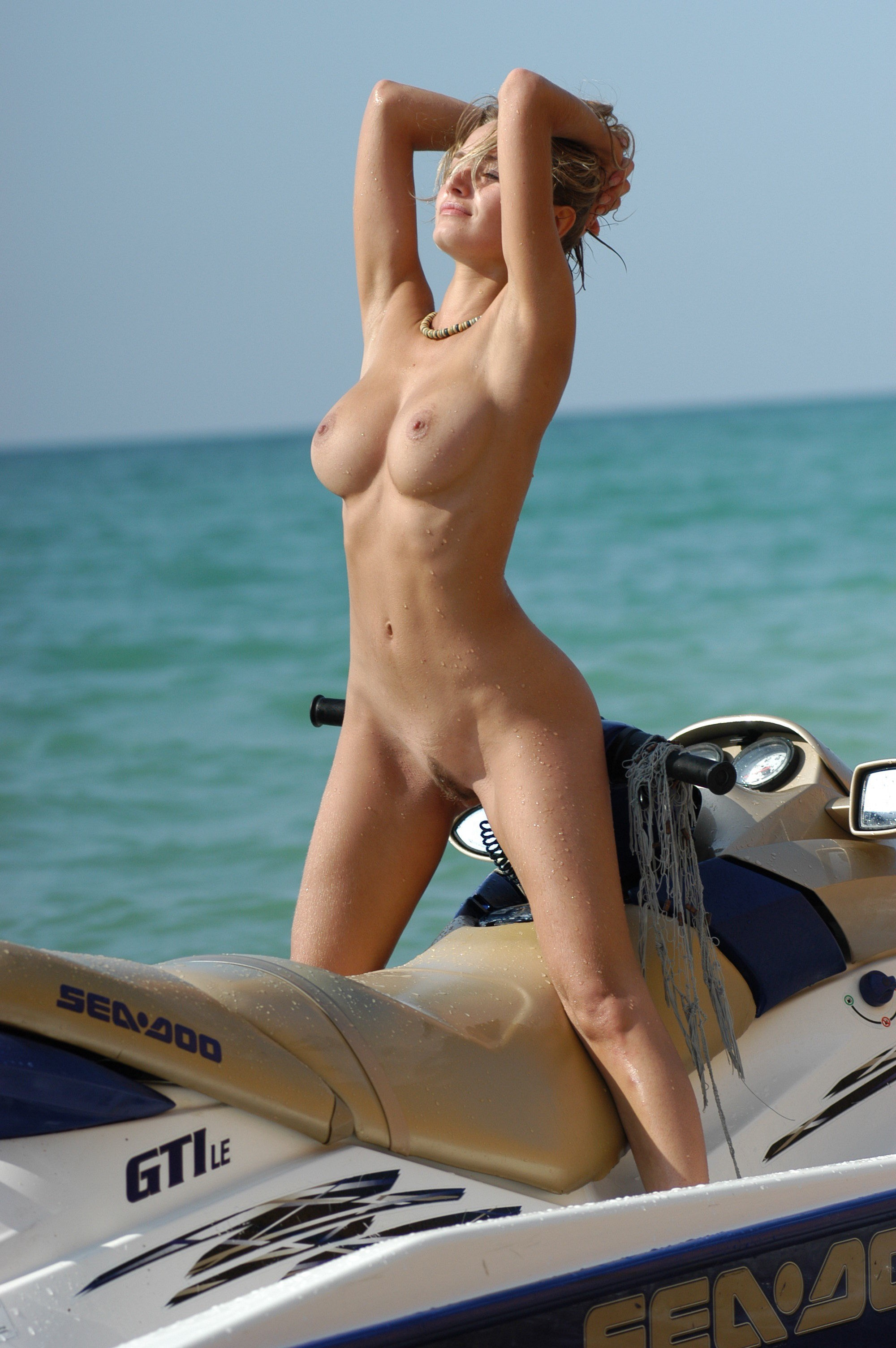 Sexy naked women on jet ski