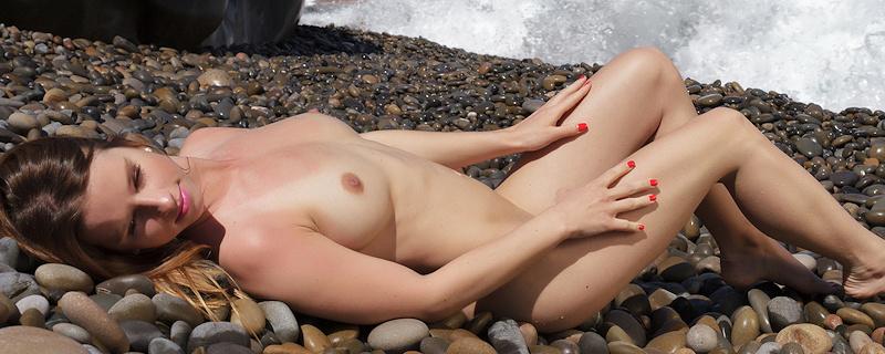 Vanessa Mio on stony beach