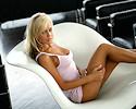 Jurgita Valts on a white chair