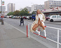 Blond girl taking a walk in fur coat