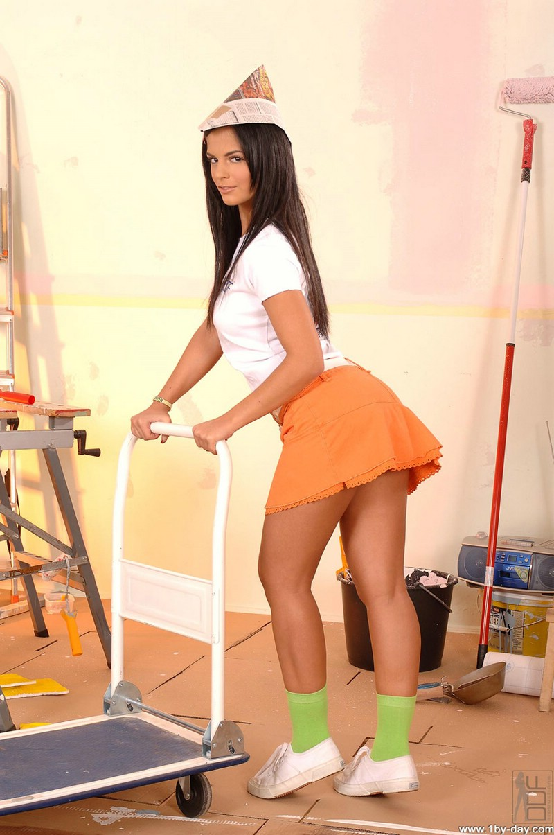 Angelika painting her room