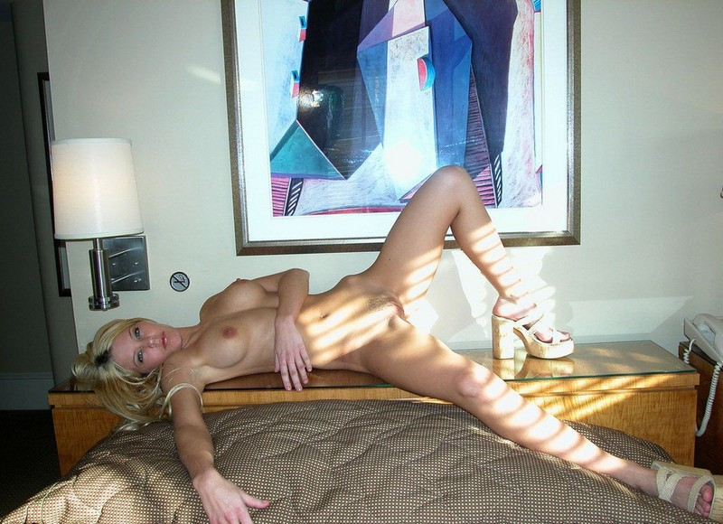 Hot blond in bedroom