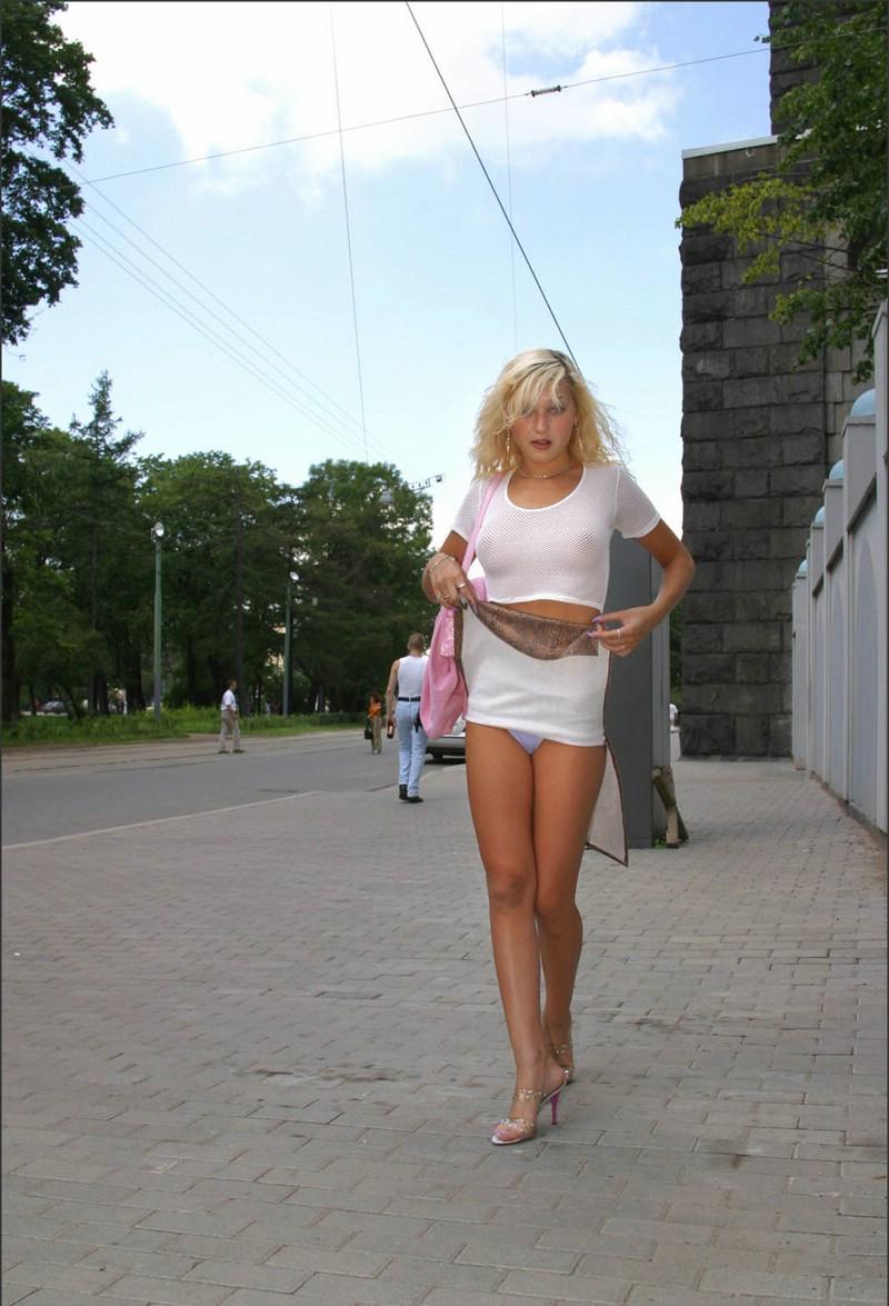Blond nude in public