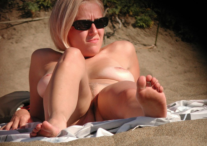 Amateur blond girl on the beach