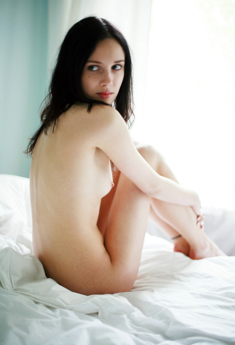 Young brunette in bed